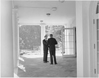 President Kennedy confers with Attorney General Robert Kennedy, October 1962