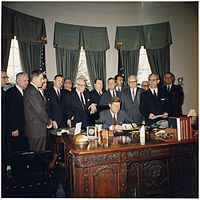 Kennedy signing the Manpower Development and Training Act, March 1962