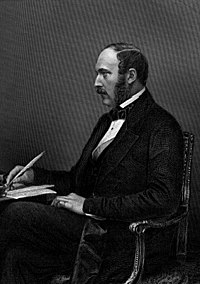 Prince Albert wearing a black frock coat with silk-faced lapels and bow tie