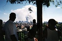 Spectators viewing the aftermath of the September 11, 2001, terrorist attacks from Doric Park. The park was later turned into Firefighter's Memorial Park.