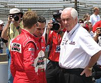 Ryan Briscoe, Hélio Castroneves, and Roger Penske at the Indianapolis Motor Speedway for Miller Lite Carb Day in 2009.