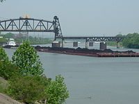 A barge hauling coal in the Louisville and Portland Canal, the only manmade section of the Ohio River