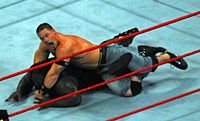 John Cena performs his STF submission hold against Mark Henry