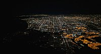 Night photograph of South Bay (Los Angeles County), 2017, with the Pacific Ocean to the left (dark region), Palos Verdes next to the right (few lights), San Pedro in the center foreground, and Terminal Island in the right foreground (bright region)