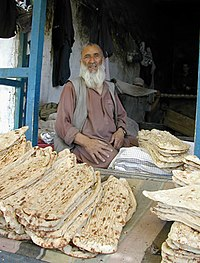 Localler selling Afghan bread in the market