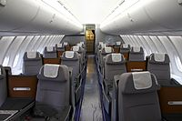 Business Class in a 2-2 layout on the upper deck of a Boeing 747-8I. Business Class on all of the airline's other wide-body aircraft has a 2-2-2 layout.