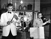Roger Moore (left) with Earl Green in The Saint