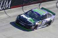 Denny Hamlin (pictured during qualifying) won the pole for the race.