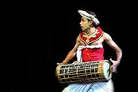 A Low Country drummer playing the traditional Yak Béra
