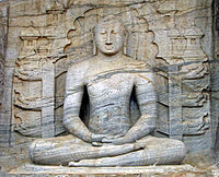 The seated image of Gal Vihara in Polonnaruwa, 12th century, which depicts the dhyana mudra, shows signs of Mahayana influence.