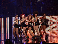 """Beyoncé performing a choreography to """"Crazy in Love"""" with her background dancers during The Mrs. Carter Show World Tour in 2013"""