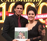 Khan with co-star Kajol in 2014 celebrating 1000 weeks continuous showing of their film Dilwale Dulhania Le Jayenge