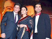 Khan with director Karan Johar and co-star Kajol at an event for My Name Is Khan in 2010
