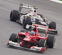 Pérez chasing Alonso for the lead of the 2012 Malaysian Grand Prix, where he achieved his first podium in Formula One