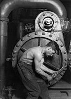 Lewis Hine's photo of power house mechanic working on steam pump