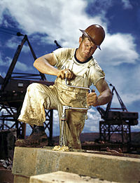 An early color photograph of a construction worker
