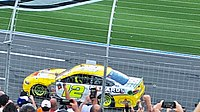 Ryan Blaney drives to the finish line in the opposite direction after winning the 2018 Bank of America 400.