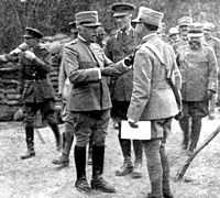 Generalissimo Luigi Cadorna (the man to the left of two officers to whom he is speaking) while visiting British batteries during World War I