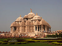alt=A complete view of Akshardham temple with people entering the temple. Swaminarayan Akshardham in Delhi is the largest Hindu temple complex in the National Capital Territory. Hinduism is the predominant faith in Delhi.<ref>{{cite news first=Preeti  last=Jha  url=http://www.expressindia.com/latest-news/Guinness-comes-to-east-Delhi-Akshardham-worlds-largest-Hindu-temple/254631/  title=Guinness comes to east Delhi: Akshardham world's largest Hindu temple  date=26 December 2007  newspaper=The Indian Express  access-date=2 January 2008  archive-url=https://web.archive.org/web/20071228055300/http://www.expressindia.com/latest-news/Guinness-comes-to-east-Delhi-Akshardham-worlds-largest-Hindu-temple/254631/  archive-date=28 December 2007  url-status=dead }}</ref>