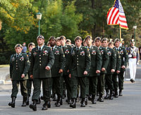 The Ranger Honor Platoon marching in their tan berets and former service uniform