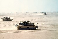 M1 Abrams tanks moving out before the Battle of Al Busayyah during the Gulf War