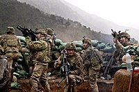 U.S. Army soldiers with the 2nd Battalion, 327th Infantry Regiment, 101st Airborne Division returning fire during a firefight with Taliban forces in Barawala Kalay Valley in Kunar province, Afghanistan, March 2011