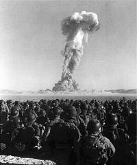 U.S. Army soldiers observing an atomic bomb test of Operation Buster-Jangle at the Nevada Test Site during the Korean War