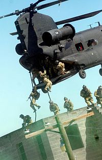 U.S. Army Rangers practicing fast roping techniques from an MH-47 during an exercise at Fort Bragg