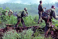 A U.S. Army infantry patrol moving up to assault the last North Vietnamese Army position at Dak To, South Vietnam during Operation Hawthorne