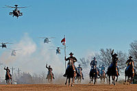 The 1st Cavalry Division's combat aviation brigade performing a mock charge with the horse detachment