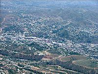 Aerial photograph of the United States-Mexican border, running diagonally from left to right, between Nogales, Arizona, United States, and Nogales, Sonora, Mexico (upper right)