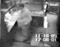 Surveillance video frame of Pollard in the act of stealing classified documents