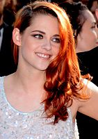 """Kristen Stewart in 2014, with her hair dyed """"orangey-red"""" for the role."""