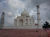 Taj Mahal in cloudy weather and its minaret under restoration