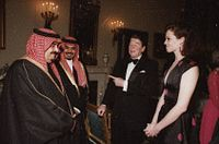 Reagan with actress Sigourney Weaver and King Fahd of Saudi Arabia in 1985. The U.S. and Saudi Arabia supplied money and arms to the anti-Soviet fighters in Afghanistan.