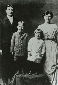"""{{circa}} 1916–17. Pictured from left: Father Jack, older brother Neil, Reagan (with """"Dutchboy"""" haircut), and mother Nelle"""