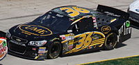 Yeley competing in the 2013 STP Gas Booster 500.