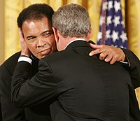 President George W. Bush embraces Ali after presenting him with the Presidential Medal of Freedom in 2005, during ceremonies at the White House