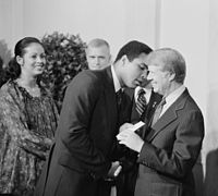 President Jimmy Carter greets Ali at a White House dinner, 1977