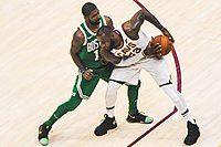 James protects the ball from Kyrie Irving in October 2017. The two were teammates in Cleveland for three seasons.