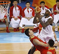 James attempts a shot over China's Yao Ming at the 2008 Summer Olympics.