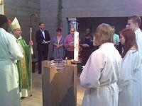Confirmation being administered in an Anglican church