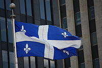 The Fleurdelisé flying at Place d'Armes in Montreal