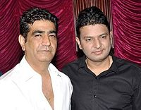 Krishan Kumar (left) and CEO Bhushan Kumar (right), the brother and son of Gulshan Kumar, respectively, during the audio release of Aashiqui 2 (2013)