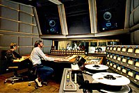Musicians working in a recording studio.