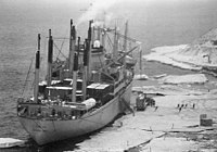 Severe cracks in an ice pier in use for four seasons at McMurdo Station slowed cargo operations in 1983 and proved a safety hazard.