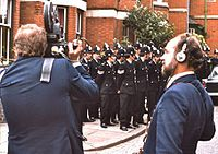 """Film crew at work during an """"anti-Fascist"""" march in Leicester, August 1974"""