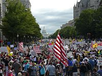 Tea Party protesters walk towards the United States Capitol during the Taxpayer March on Washington, September 12, 2009.