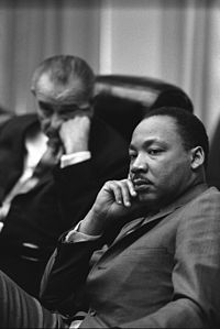 Civil Rights leader Martin Luther King Jr. (right), with President Lyndon B. Johnson in the background (left)