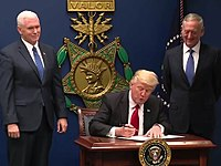 Trump signing Executive Order 13769 at the Pentagon as the Vice President Mike Pence and Secretary of Defense James Mattis look on, January 27, 2017